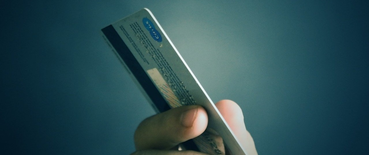 Photo of hand holding a bank or credit card