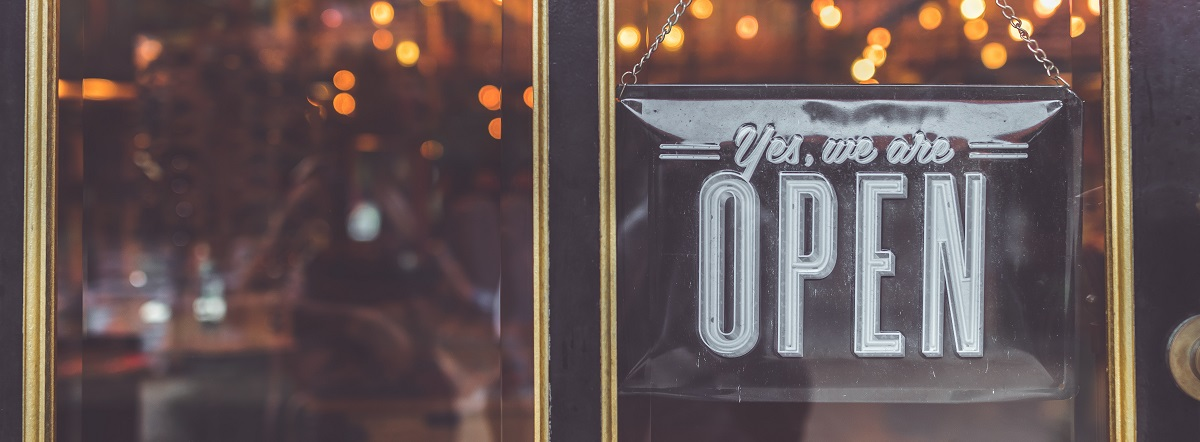 Shop showing an open sign in the door window