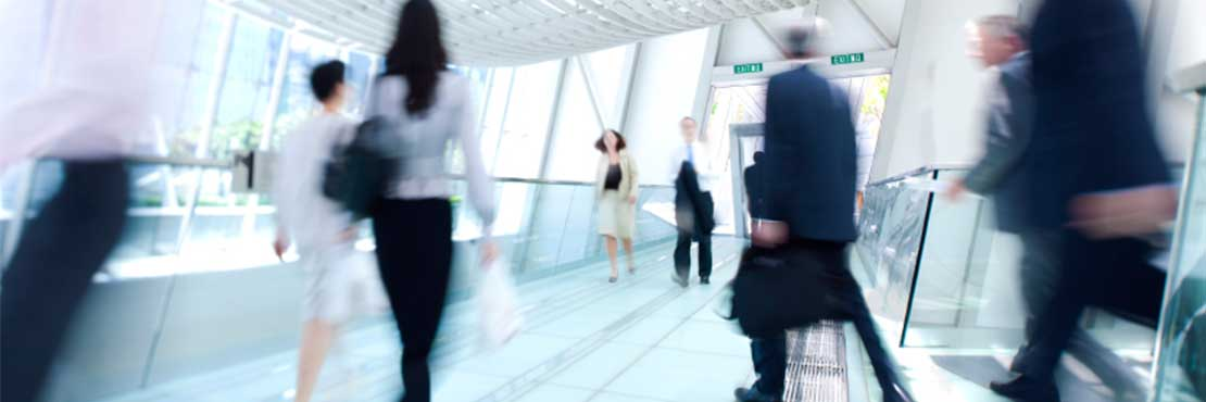 Man and women in suits walking very fast