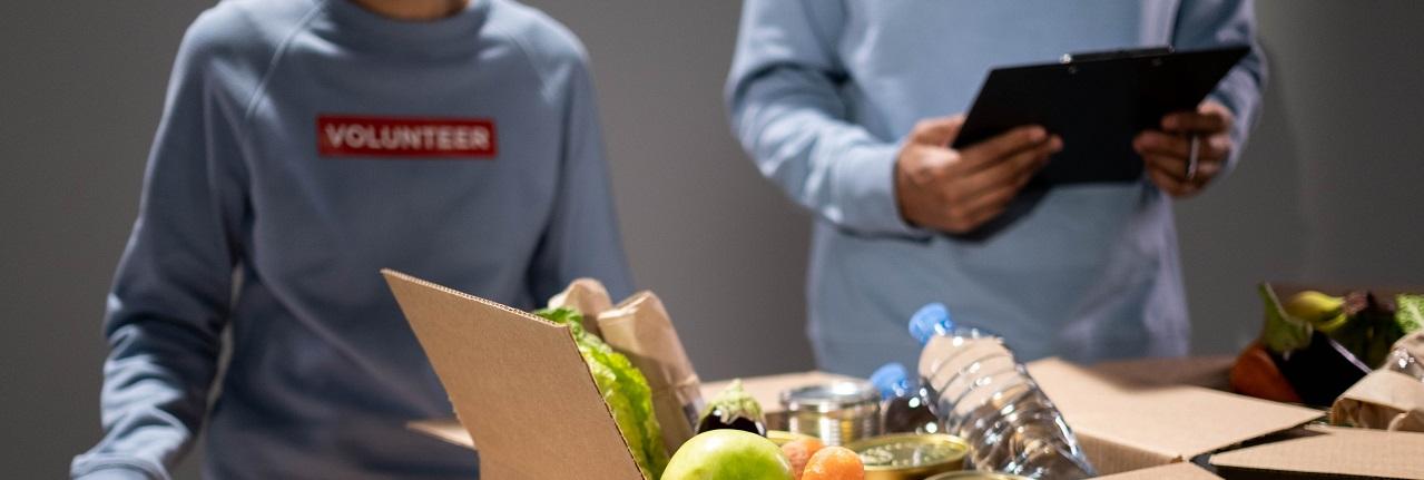 Photo of two volunteers in food bank, packaging food