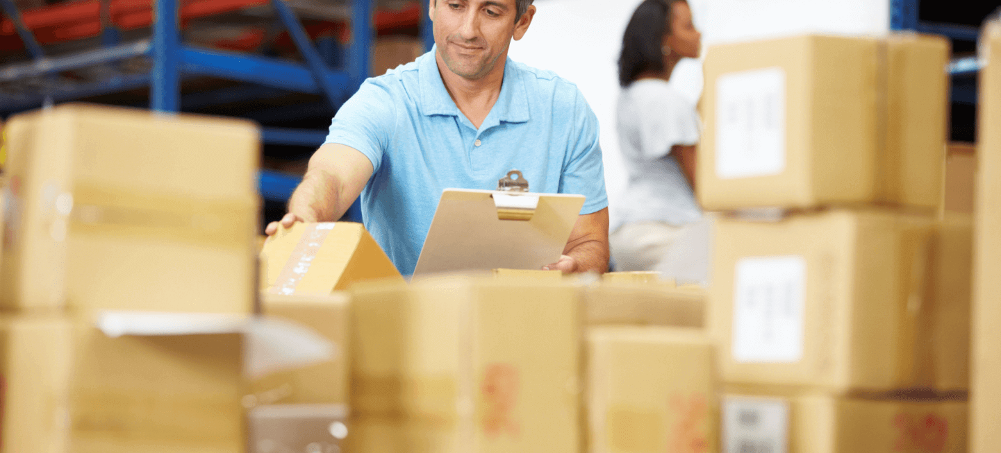 man with boxes in logistics job