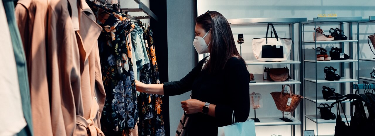 Photo of lady shopping with face mask on