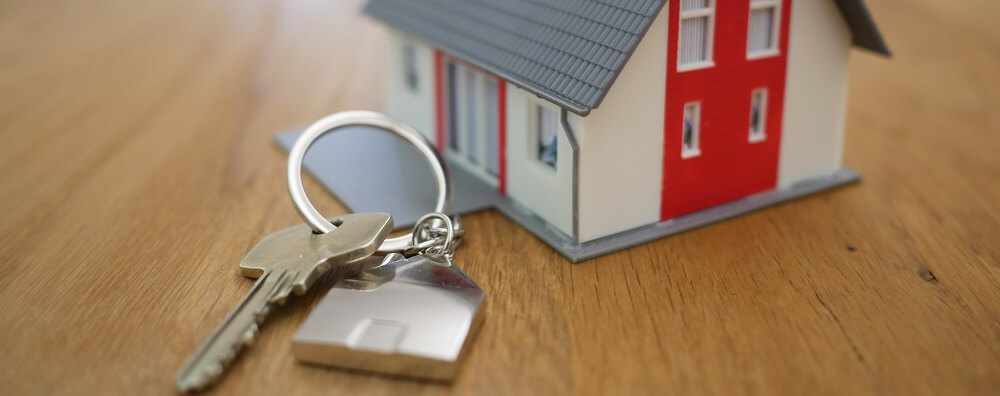 Photo of toy house and house keys representing mortgage