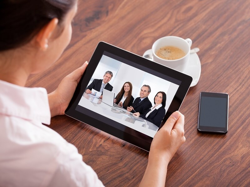 Woman Video Conferencing On Digital Tablet