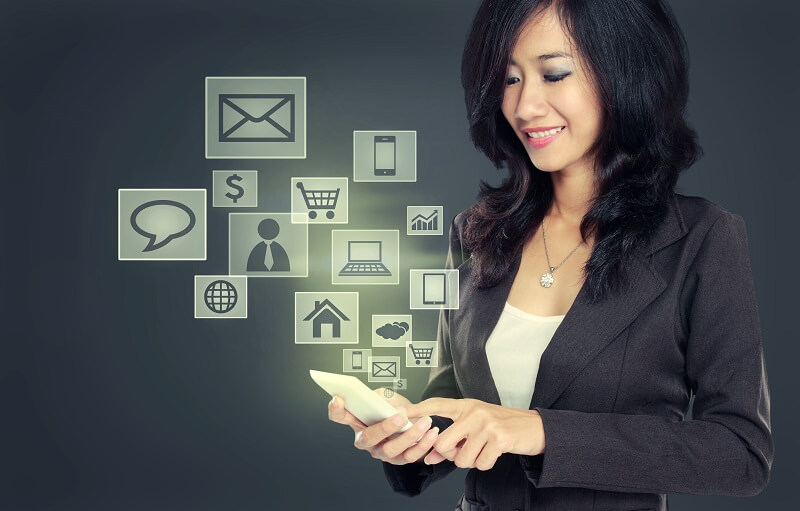 business woman smiling while using Modern communication technology mobile phone concept on high tech background