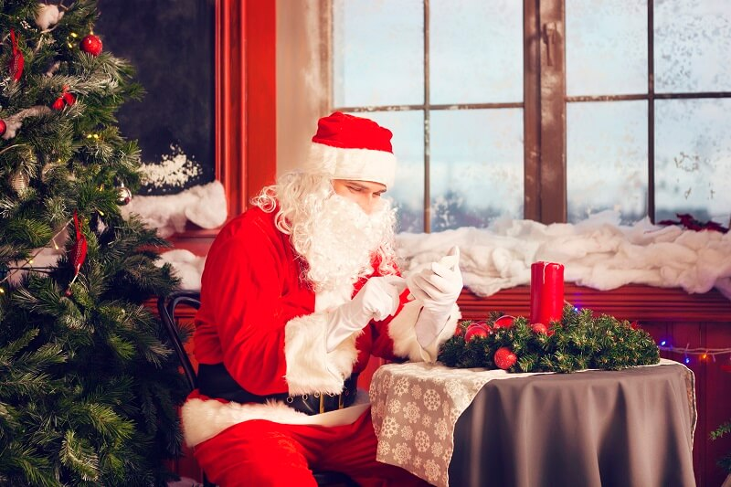 Santa Claus using a smart phone