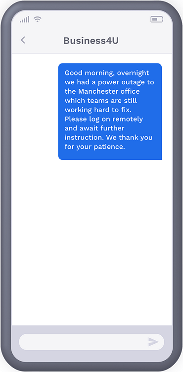 Phone showing text message from a utility firm to recipient, notifying them of outage