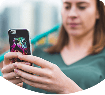 Photo of lady sat looking at her mobile phone