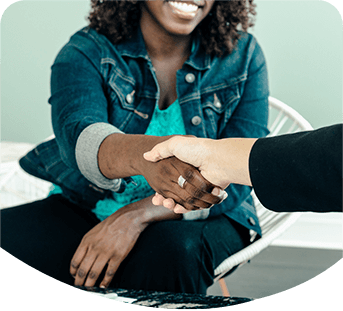 Photo of two people shaking hands on job offer